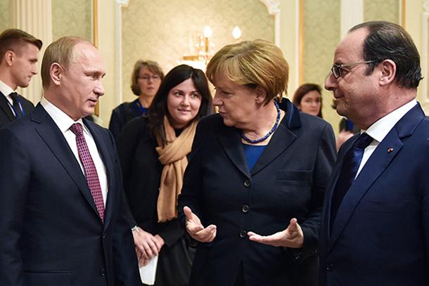 Владимир Путин, Ангела Меркель и Франсуа Олланд. Фото: Николай Лазаренко/ТАСС