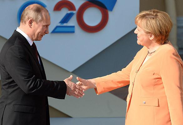 Владимир Путин и Ангела Меркель. Фото: Ramil Sitdikov/Getty Images