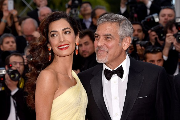 Амаль Аламуддин и Джордж Клуни. Фото: Clemens Bilan/Getty Images