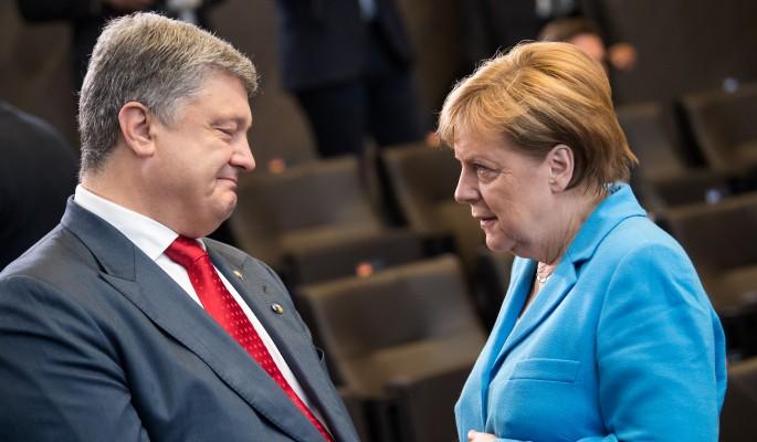 Меркель всадила нож в спину Порошенко ради дружбы с Путиным