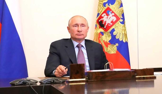 Путин поиграл с ручкой во время совещания (видео)