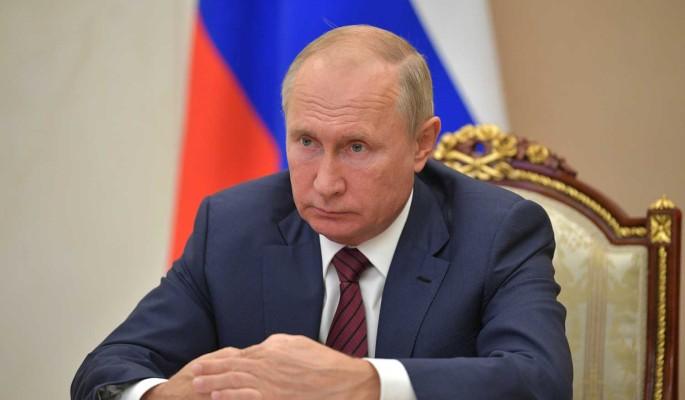 Путин: Работа с архивами помогает раскрыть преступления нацистов