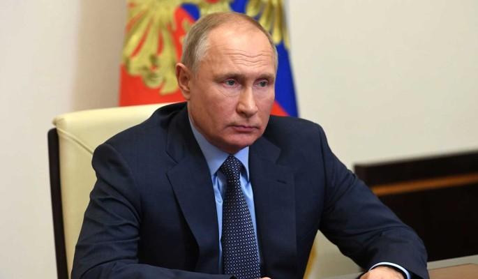 Биограф Путина назвал причину напряженных отношений президента с Меркель