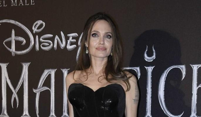 Джоли развлекалась в компании темнокожего красавца: Новый любовник?